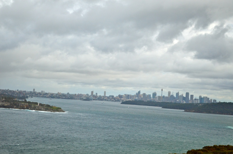 The weather was not in our favor, but on a clearer day you could better see the outline of the city between the Manly Beach cliffs.