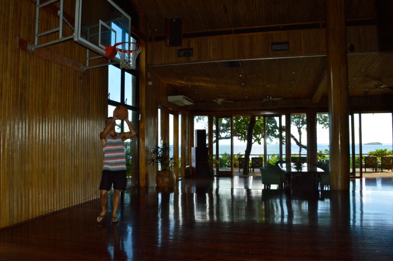 Sean shooting hoops in the entertainment center. Notice the scenery through the windows.